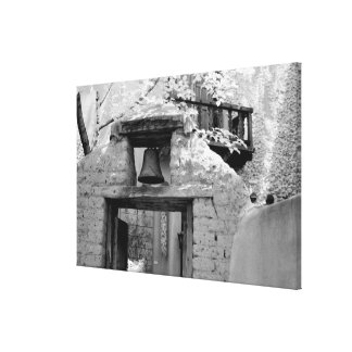Rough adobe bell in entryway, Santa Fe, New Canvas Print