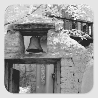 Rough adobe bell in entryway, Santa Fe, New Square Sticker