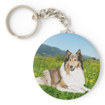 Rough Collie against a buttercup meadow. Keychain
