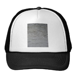 Rough gray concrete wall texture with relief lines trucker hat