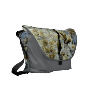 Rough stone with crack messenger bag