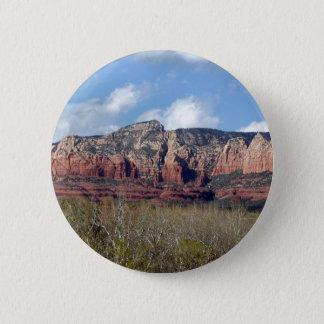 round button with photo of Arizona red rocks