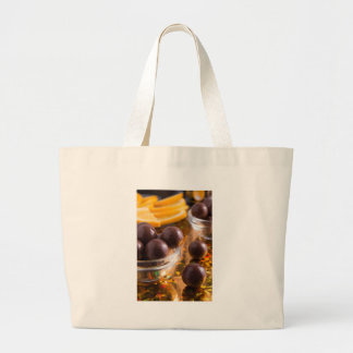 Round candy chocolate close-up large tote bag