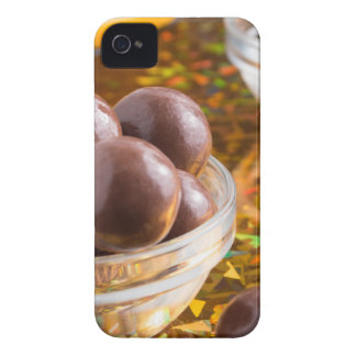 Round candy chocolate close-up on a colorful Case-Mate iPhone 4 case