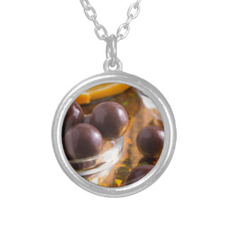 Round candy chocolate close-up silver plated necklace