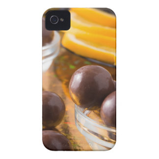 Round candy  from chocolate close-up on a colorful iPhone 4 cover