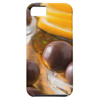 Round candy  from chocolate close-up on a colorful iPhone SE/5/5s case