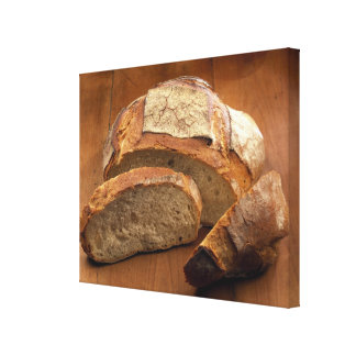 Round country-style bread cut in slices For Canvas Print