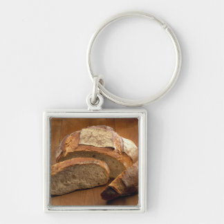 Round country-style bread cut in slices For Silver-Colored Square Keychain
