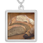 Round country-style bread cut in slices For Square Pendant Necklace