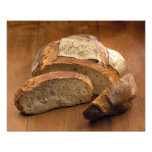 Round country-style bread cut in slices For Photo Print