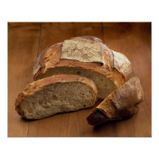 Round country-style bread cut in slices For Poster