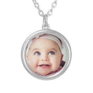 round necklace with baby picture inside