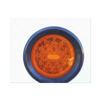 round orange taillight auto part canvas print