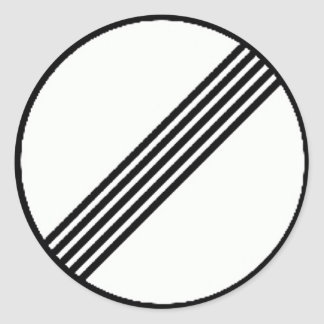 Round sticker with Restriction ends sign.