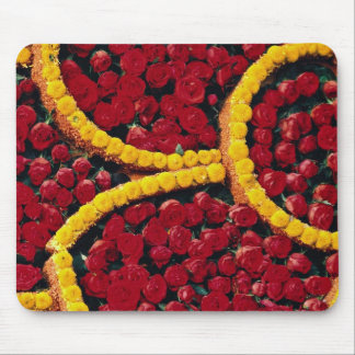 Rounded drops of red roses and yellow flowers mousepads
