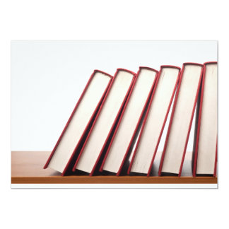 Row of books falling in sequence card