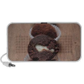 Row of chocolate truffles on wood mini speakers