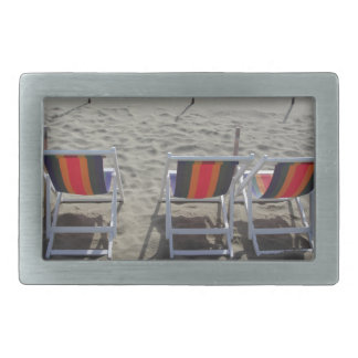 Row of colorful wooden chairs at beach belt buckle