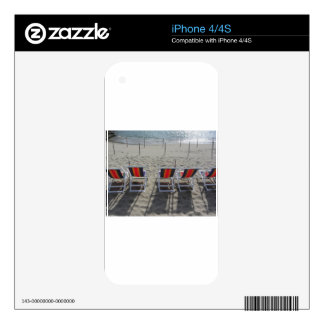 Row of colorful wooden chairs at beach skins for iPhone 4S