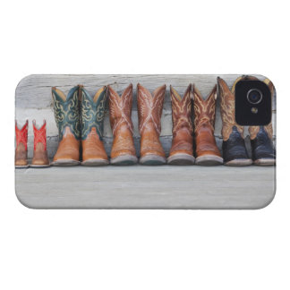 Row of cowboy boot on porch of log cabin Case-Mate iPhone 4 case