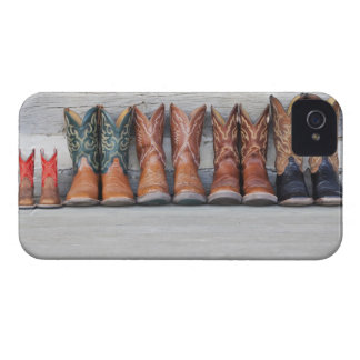 Row of cowboy boot on porch of log cabin iPhone 4 Case-Mate case