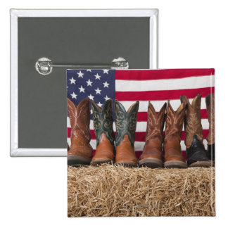 Row of cowboy boots on haystack 2 inch square button