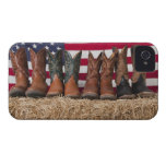 Row of cowboy boots on haystack iPhone 4 covers
