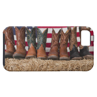 Row of cowboy boots on haystack iPhone 5 cover