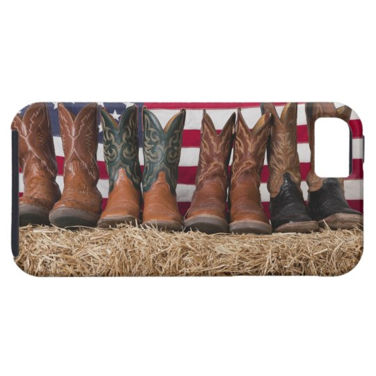 Row of cowboy boots on haystack iPhone SE/5/5s case