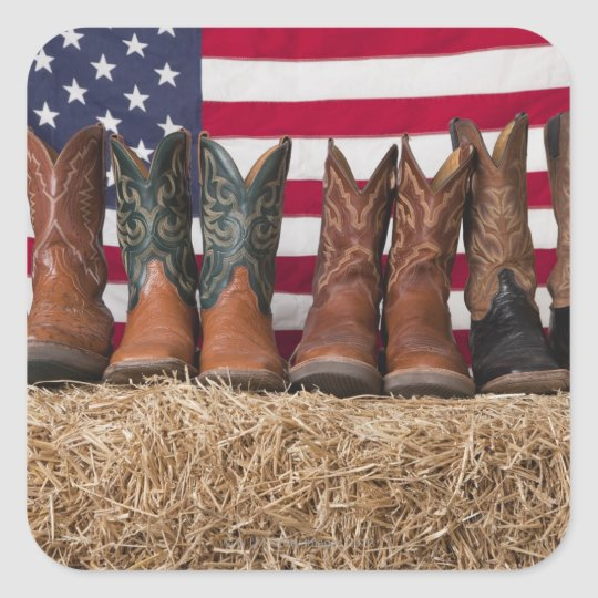Row of cowboy boots on haystack square sticker