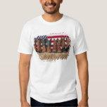 Row of cowboy boots on haystack tee shirt