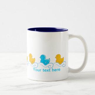 row of cute ducks mugs
