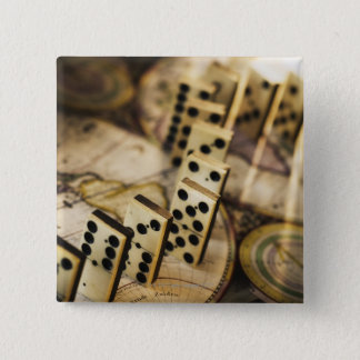 Row of dominoes on old world map 2 button