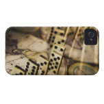 Row of dominoes on old world map 2 iPhone 4 cover
