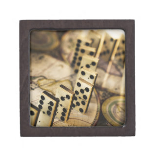 Row of dominoes on old world map 2 premium jewelry box