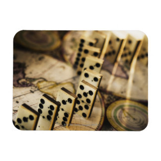 Row of dominoes on old world map 2 rectangular photo magnet