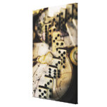 Row of dominoes on old world map stretched canvas print