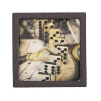 Row of dominoes on old world map premium jewelry boxes