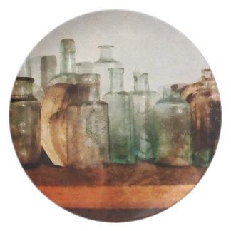 Row of Medicine Bottles Melamine Plate