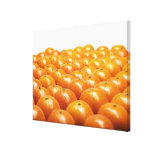 Row of oranges stretched canvas prints