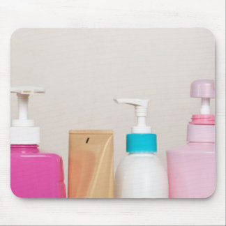 Row of toiletry bottles mouse pad