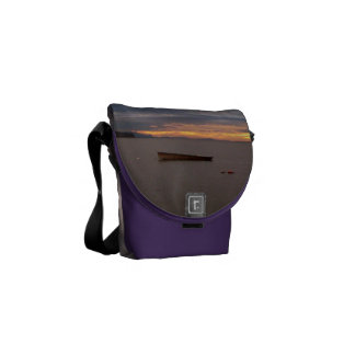 Rowboat At Sunset Courier Bags