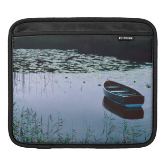 Rowboat on small lake surrounded by water iPad sleeve