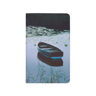 Rowboat on small lake surrounded by water journal