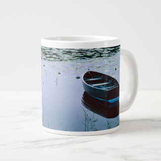 Rowboat on small lake surrounded by water large coffee mug