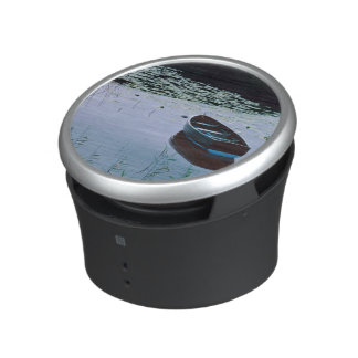 Rowboat on small lake surrounded by water speaker