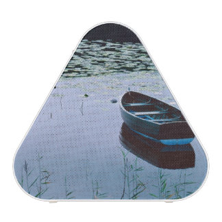 Rowboat on small lake surrounded by water bluetooth speaker