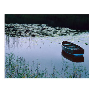 Rowboat on small lake surrounded by water postcard