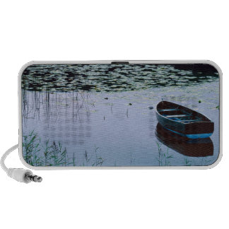 Rowboat on small lake surrounded by water portable speakers